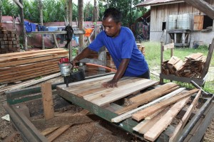 A member of staff of PT Mitra Pallet Consortium Jaya makes wooden pallets. (JP/Arief Suhardiman)
